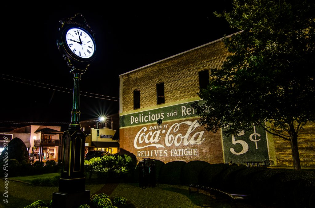 New Albany clock and Coca-Cola mural